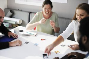 Students working together with cards on table