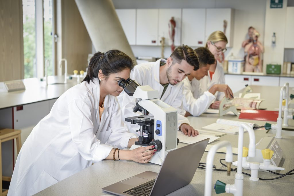 Students participating in research in a laboratory