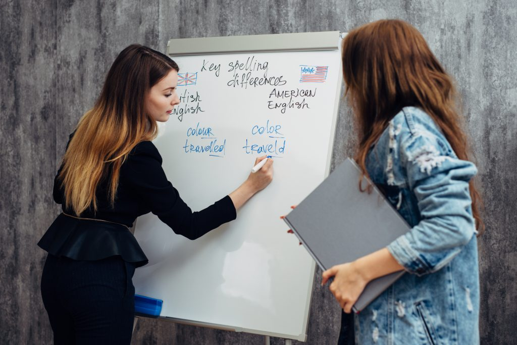 Woman writing on a standing whiteboard